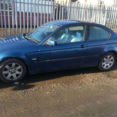 Side view of blue BMW
